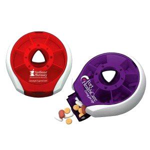 Mult coloured pill dispensers branded